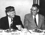 Photograph of Senate President Clarence Carpenter dining with Senator Benjamin Arnold, at an...