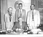 Photograph of Governor Ernest McFarland signing legislation at the Capitol in Phoenix (Ariz.)