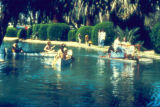 Photograph/color image of people boating and using paddle boats at Encanto Park in Phoenix (Ariz.).