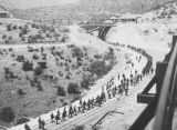 Photograph of laborers being marched out of town at Cananea (Mexico) during labor unrest at the...