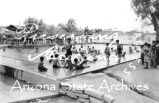 Photograph of a swimming pool scene in Tucson (Ariz.).