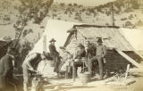 Photograph of men, probably miners, at a camp in Carbonateville (Ariz.).