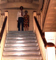 Photograph of a man and a woman standing on the steps of the Gila County Courthouse in Globe...