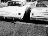 Photograph of two cars re-creating an accident scene in Phoenix (Ariz.).