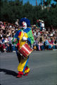 Photograph of a clown performing in an Arizona parade.