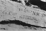 Photograph of graffiti carved on a fort in Navajo County (Ariz.).