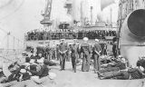 Photograph of sailors dressed for ceremony aboard the Battleship U.S.S. Arizona