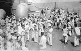 Photograph of sailors at a social occasion aboard the Battleship U.S.S. Arizona