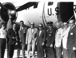 Photograph of a group of men near an Air Force plane in Colorado Springs (Colo.).
