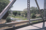 Photograph of the Perkinsville Bridge and the Verde River in Perkinsville (Ariz.).