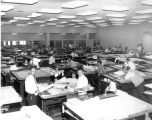 Photograph of the drafting room at the Phoenix Engineering office of the Arizona Highway...