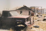 Photograph of junk, an abandoned truck and dilapidated house in Randolph (Ariz.) on Arizona...
