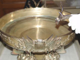 Photograph of pieces from the silver service of the U.S.S. Arizona at the Arizona Capitol Museum...