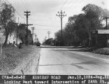 Photograph of a Civil Works Administration road construction project on Henshaw Road at 24th...