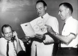 Bob Hope receives a copy of Deadline, Arizona Press Club's annual publication, from Lloyd Clark,...