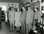 Interior image of the Womens Air Corps (WAC) cottage.  Pictured left to right, Major Leslie C....