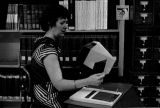 Photograph of a patron using microfiche at the Arizona State Library in Phoenix (Ariz.)