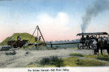 Photograph/colorized postcard of a machine harvesting crops in the Salt River Valley of Arizona