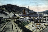 Photograph/colorized postcard of the smelter at the Congress Mine in Congress (Ariz.)