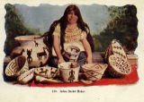 Photograph/colorized postcard of a Native American woman making baskets