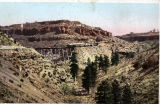 Photograph/colorized postcard of the railroad bridge and train in Johnson's Canyon, Coconino...