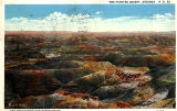 Photograph/colorized postcard of the Painted Desert, a multi-colored land formation in Apache...