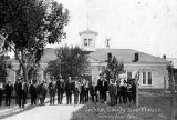 Photograph of a jury gathered in front of the Graham County Courthouse in Solomonville (Ariz.)...