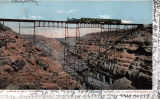 Photograph/colorized postcard of the iron railroad bridge over Canyon Diablo (Ariz.)