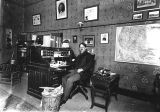 Photograph of James McClintock in an office in Phoenix (Ariz.), possibly the U.S. Post Office.