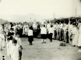 Photograph of a crowd gathered for a religious procession at a mission in Bavispe (Mexico).