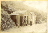 Photograph of miners standing near a mining shed in Morenci (Ariz.)