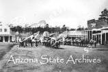Photograph of the streets of Prescott (Ariz.), with several saloons in the foreground and Thumb...