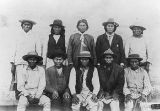 Photograph of the Apache Kid, an outlaw, and military scouts in Gila County (Ariz.)