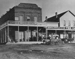 Photograph of a Prescott (Ariz.) street scene showing Bowen, Knowles & Co., the Capital Saloon...
