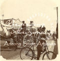 Photograph of a horse-drawn fire engine and firemen in a parade in Phoenix (Ariz.)