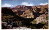 Photograph/colorized postcard of an automobile on the Apache Trail in Maricopa County (Ariz.)