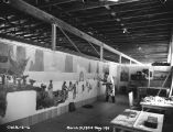 Photograph of an artist painting as part of a Civil Works Administration project, probably in...