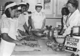 Photograph of young women being trained as food preparers by the Works Progress Administration in...