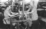 Photograph of Works Progress Administration laborersworking with a loom in Phoenix (Ariz.)