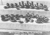 Photograph of various pottery created by Native American women as part of the Woman's Service...