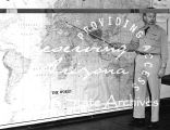 Photograph of an Air Force officer pointing to Germany on a map at Luke Air Force Base in Glendale...