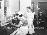 Photograph of nurses working at the Sage Memorial Hospital on the Navajo Reservation in Ganado...