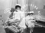 Photograph of nurses caring for babies at the Sage Memorial Hospital on the Navajo Reservation in...