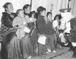 Photograph of Navajo mothers and children on the Navajo Reservation in northern Arizona