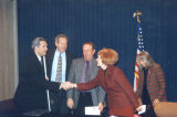 Photograph of Governor Jane Hull signing legislation facilitating services for visually impaired...