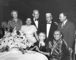 Photograph of Clarence Salsbury and other people gathered at an unidentified celebration.  Annie...