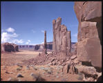 Desert Figures in Monument Valley, Arizona. The slender Totem Pole is 1006 ft. tall and together...