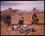 Navajo Indian Camp, Monument Valley, Ariz. Against the dramatic background of rock formations, an...