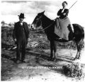 Winfield Scott standing next to Helen on horse