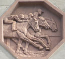 Relief of Three Men Racing Horses